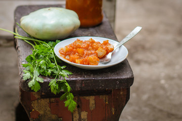 bush pumpkin in tomato sauce (a portion food) - conservation of products. food background
