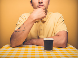 Thoughtful man drinking coffee