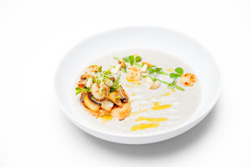 Cream mushroom soup with scallops, herbs and toast bread.