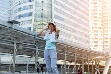 Young Sport woman with exercising outdoor. Happy Smile and Lifestyle Concept.