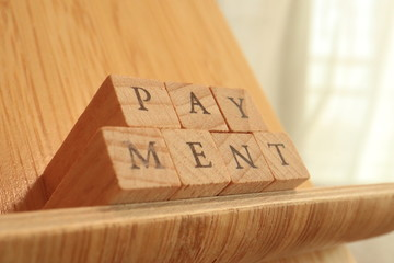 Wooden Block Text of Payment