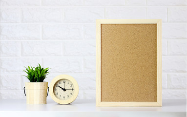 Mock up interior wood frame poster and tree in room office on white brick wall background,Copy space.