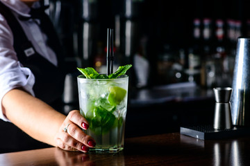 Cold fresh Mojito cocktail on the bar counter