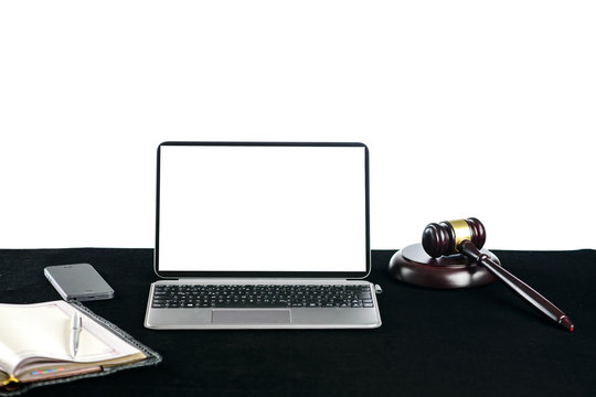 Wooden judges gavel near laptop with copyspace for text on light