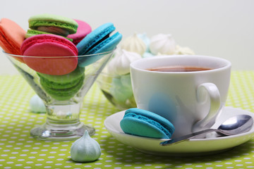 A cup of coffee and macaroons ready for breakfast
