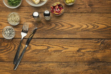 Empty wooden table with knife and fork