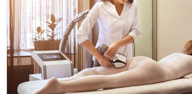 Female having procedure of massage on legs