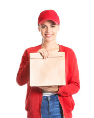 Young woman with paper bag on white background. Food delivery service