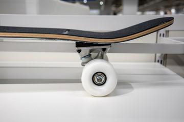 White skateboard wheel on white shelf for display