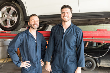 Mechanics Smiling In Auto Repair Shop