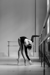 Beautiful ballerina training in the class