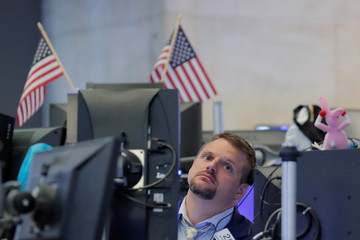 A trader works in a work space on the floor of the NYSE in New York