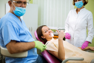 Dentist check up and repair tooth of young girl