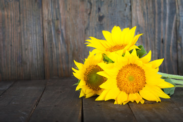Bouquet of sunflowers laying on vintage wooden table. Still Life.