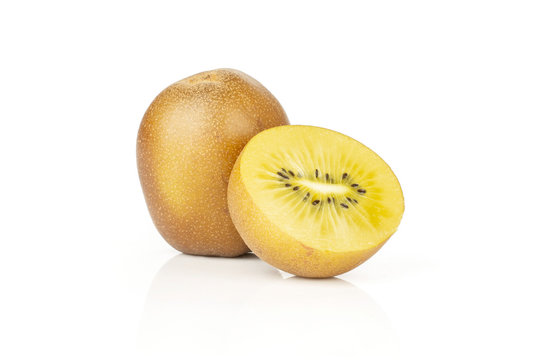 Group of one whole one half of fresh golden brown kiwi fruit sungold variety isolated on white