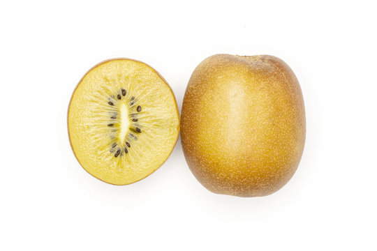 Group of one whole one half of fresh golden brown kiwi fruit sungold variety flatlay isolated on white