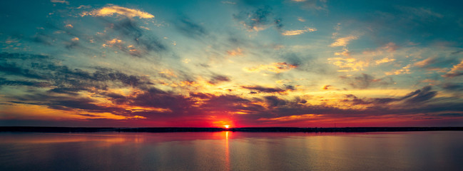Aerial panoramic view of sunset on the lake