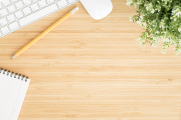 Flat lay photo of office desk with mouse and keyboard ,Top view workpace on bamboo wood table and copy space