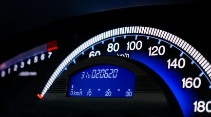 Blue car speed meter console dashboard panel