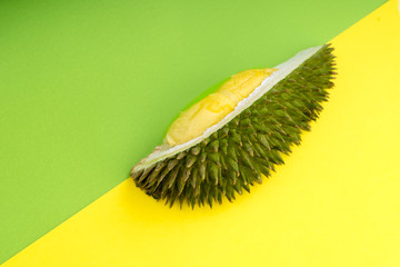 Durian fruits on yellow and green pastel background.