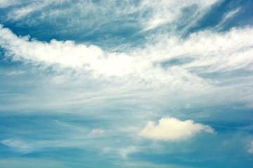 Cloudy, blue sky