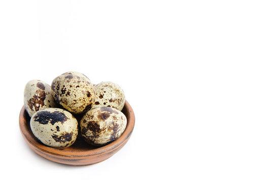 Fresh quail eggs in a bowl
