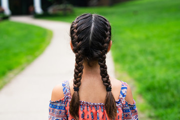 Back view of girl with braids