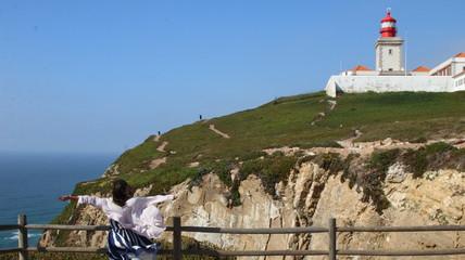 Cabo da Roca Lighthouse. Sintra. Portugal. Traveller woman