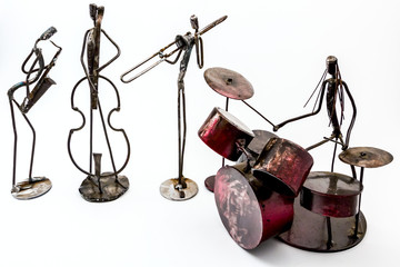 Creative figures of musicians, saxophone, violoncellist, drummer and trumpet are playing together