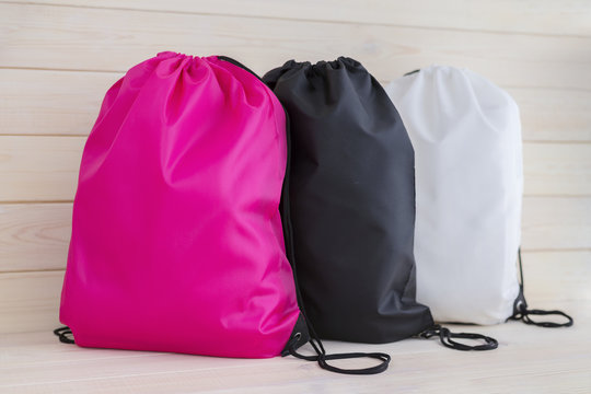 Three drawstring pack template, bag for sport shoes isolated on white