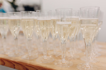 Row of plastic disposable glasses champagne. A restaurant catering