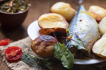 one big fish mackerel baked with young potatoes