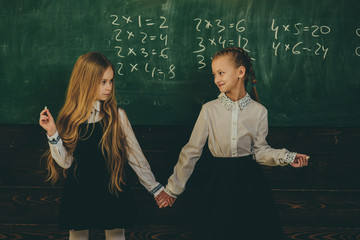 friendship. friendship of two school girls. friendship concept. friendship relations of little girls in school. work hard play hard.