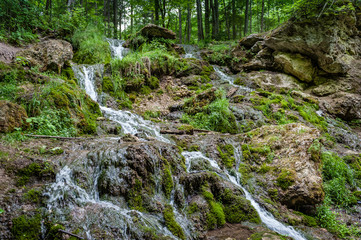 View of cascading water falling over the rocks. Waterfall of The Seven Springs in Gauja national park. Latvia.