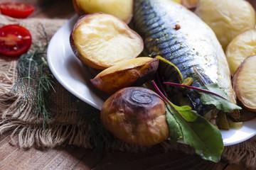 one big fish mackerel baked with potatoes