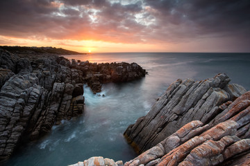 Beautiful sunset over the sandstone cliffs along the coastline of De Kelders in Gansbaai in the Overberg of south africa