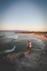 A couple looking over the ocean at th efamous De Kelders in Gansbaai in the Overberg region of south africa