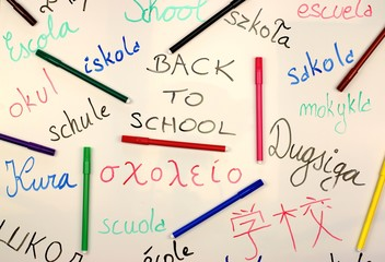 International back to school background on a white board with colored markers.