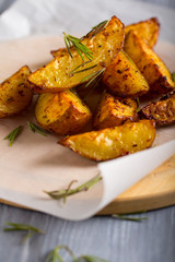 grilled potatoes rosemary wooden background
