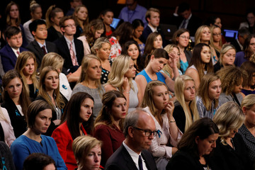 "Survivors and supporters of sexual abuse victims in the U.S. Gymnastic program look on during a Commerce Subcommittee hearing entitled ""Strengthening and Empowering U.S. Amateur Athletes: Moving Forward with Solutions"" on Capitol Hill in Washington"