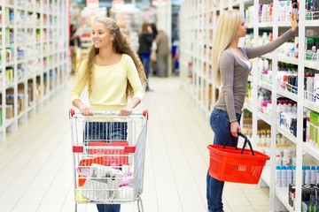 Portrait of Two Women Shopping in Supermarket