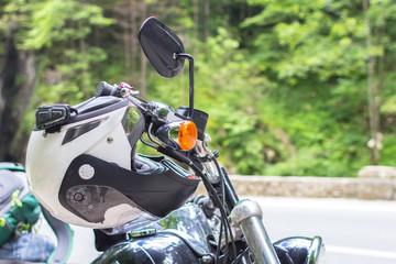 Helmet on the motorcycle handlebars