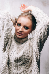 Girl smiles.The girl in the sweater.Portrait photo.Nice girl