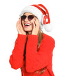 Happy young woman listening to Christmas music on white background