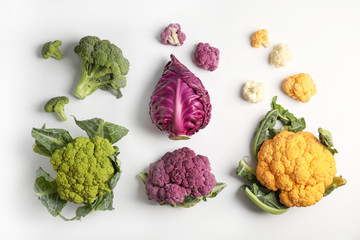 Different fresh cabbages on white background, top view. Healthy food