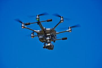 Unmanned Surveillance Drone in a Summer Sky - Emergency Services, Search and Rescue - Mapping - Surveillance