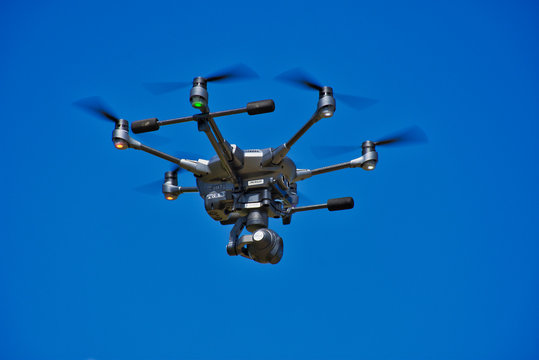 Large Security Surveillance Drone Flying  in a Blue Sky - Unmanned Surveillance Drone in a Summer Sky - Emergency Services, Search and Rescue - Mapping - Surveillance