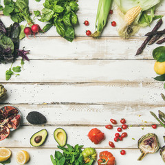 Wall Mural - Healthy raw summer vegan ingredients. Flat-lay of colorful vegetables and greens on white table background, top view, copy space, square crop. Clean eating, dietingm vegan, vegetarian party food