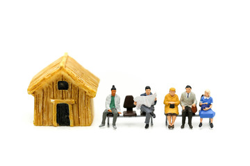 Miniature people : waiting for bus at bus station with mini house.