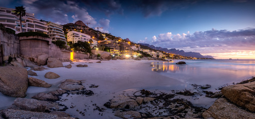 Foto auf Acrylglas Lavendel Wide angle landscape image over the multimillion dollar penthouse mansions that's built along the Clifton coast in Cape Town South Africa